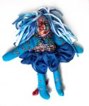 blue and orange Spirit Doll with polymer clay face