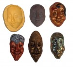 a silicone mold with the original polymer clay face and other faces made from the mold